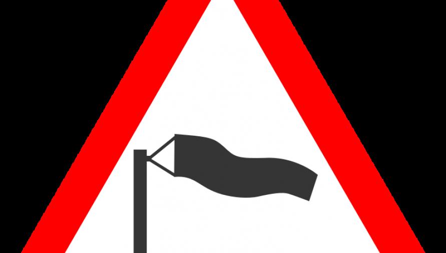 grafika przedstawia znak ostrzegawczy i worek kierunku wiatru - Kliknięcie w obrazek spowoduje wyświetlenie jego powiększenia